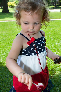 Hazel on July 4th 2013. This 2 this year. She found a lady bug and could not part with her blowpop.