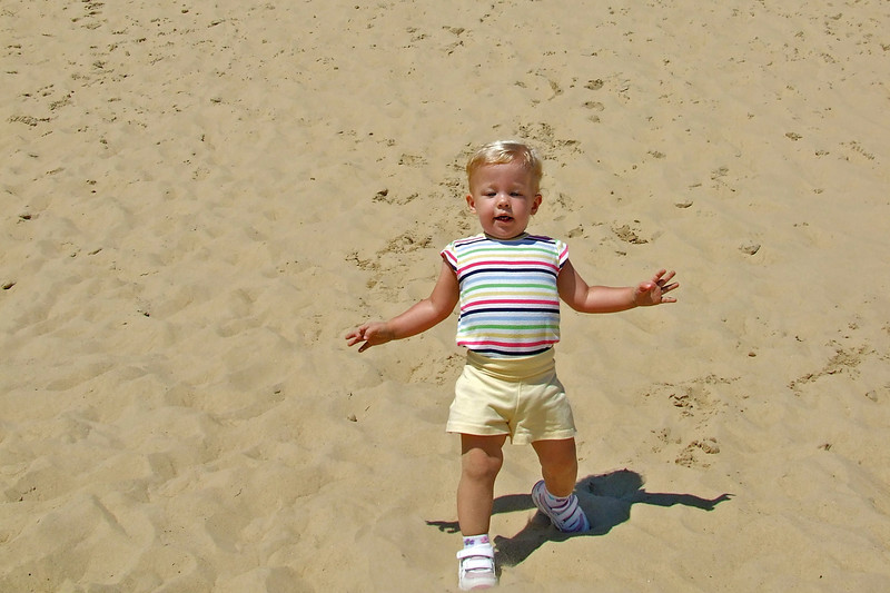 Sydney running down the sand dune