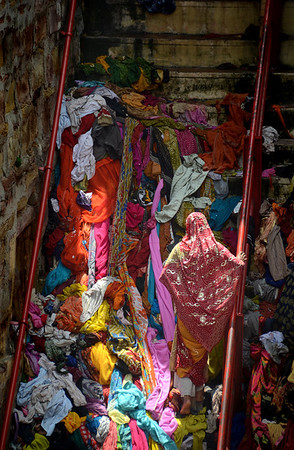 A well near where i was living in Varanasi is host to thousands of saris, thrown away by women wishing for fertility and healthy babies. After purifying themselves in the water and putting on new saris, they leave the old ones behind.