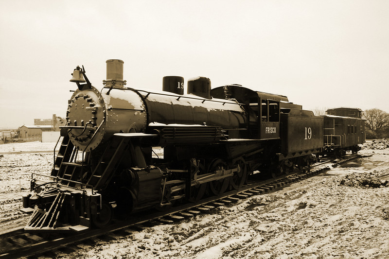 Old steam engine in the snow