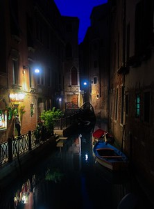 A small side canal in Venice Italy. I stood on a shaky stone bridge for many minutes waiting for foot traffic to slow down enough to keep the bridge from vibrating the camera.