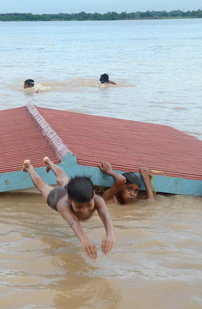 The Ganges rose quickly during the week, but that didn't stop the locals from turning the roof of this small hut into a diving board.
