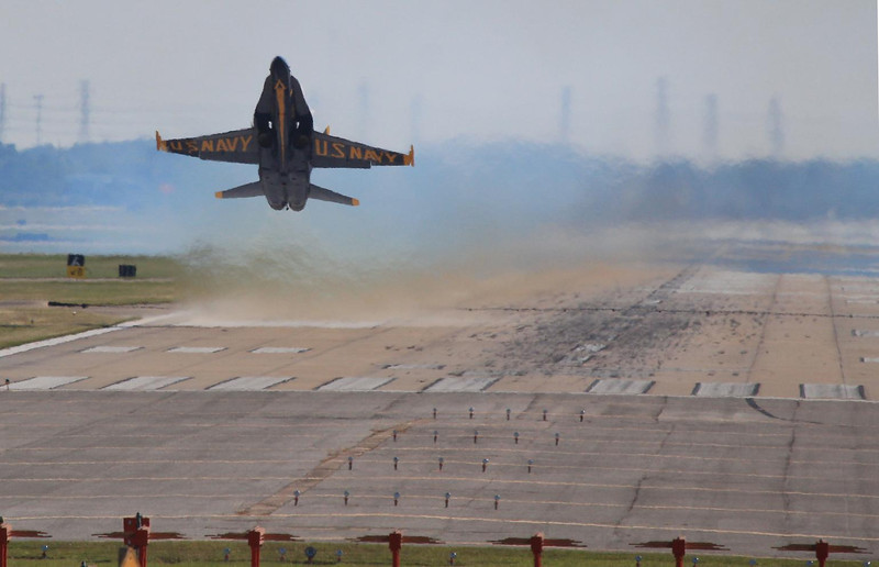 Blue Angels soloist takes off at beginning of 2012 airshow at Houston.