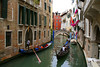 This waterway in front of the Murano Glass shop was quite busy with Gondola traffic. Venice, Italy.