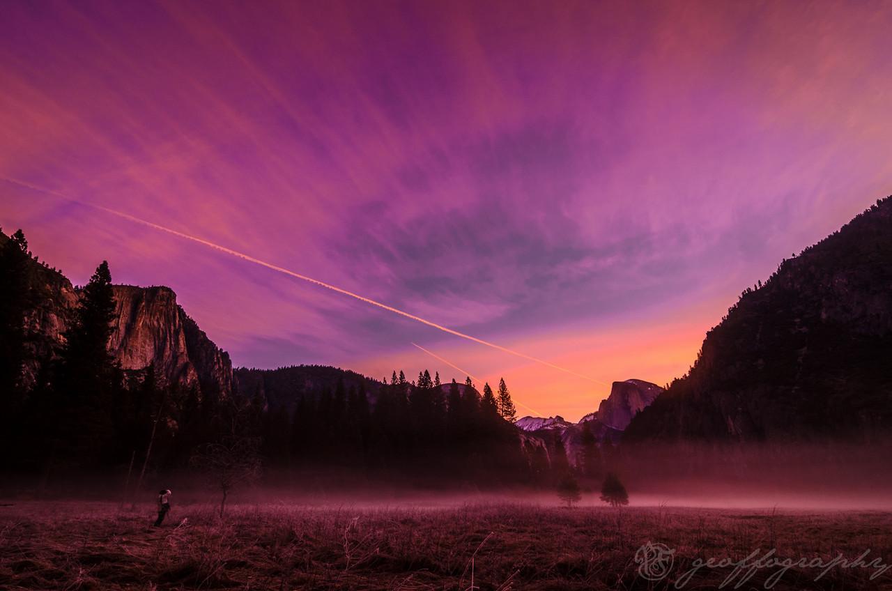 Yosemite Sunrise: contrails of passing planes accent a brilliant sunrise over Yosemite Valley