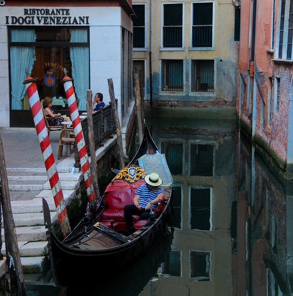 Waters are quiet in this Venice, Italy canal as the sun goes down.