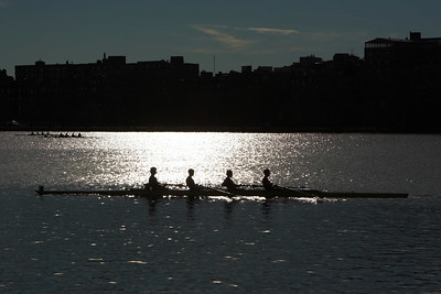 This 4 place crew returns to the start line after the race.  Early morning light gives a dramatic reflection off the water.