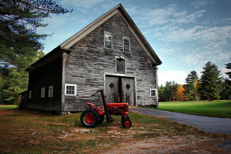 Vermont. These colors are real, and the antique tractor in front must have been left there by someone sympathetic to photographers and tourists.