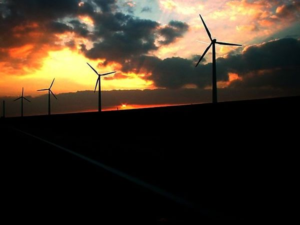 Sunset over windmills on Flevoland, driving along the A6