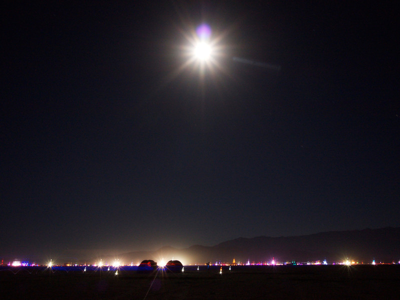 blue moon over black rock city from deep playa