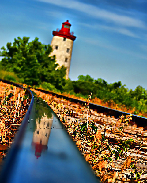 """Photo a Day for a Year"": Sunday June 13 2010, 5:11pm  ...the historic windmill (and Upper Canada Rebellion battle site) outside of Prescott Ontario. Just lucky to notice this reflection in the train rail after attempting low points of view."