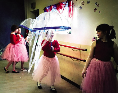 From left, Alaina Zimmermann, Emily Gromowski, Allison Wray and Lydia Garlie perform a scene  as mermaids dancing with jellyfish during a rehearsal for The Little Mermaid at Revolution School of Dance.