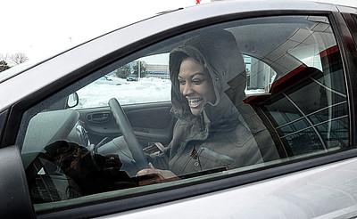 Karena Williams of Elyria picks up her car at Premier Toyota Scion in Amherst on Feb. 6. STEVE MANHEIM/CHRONICLE