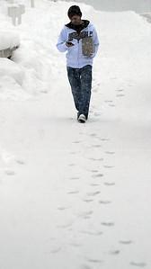 LCCC student Derek Vilk walks to class in the snow on Feb. 4.   STEVE MANHEIM/CHRONICLE