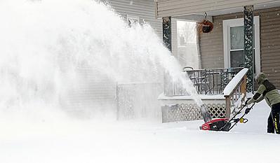 Jennifer Emory of Elyria uses a snowblower at her home on Eastern Heights Boulevard on Feb. 2.  STEVE MANHEIM/CHRONICLE