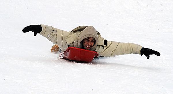 Jay Randalman of Elyria sleds at Cascade Park on Feb. 2. STEVE MANHEIM/CHRONICLE