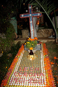 Grave made from recycled bottle caps.