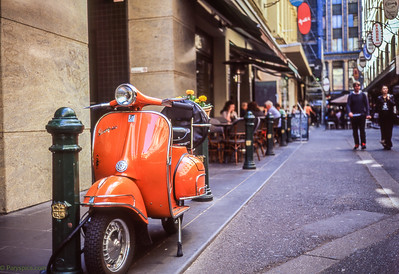 A lovely bright scooter seems to complete the mood on this melbourne street