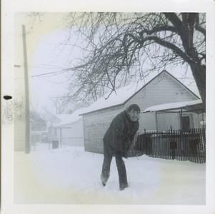 Rick throwing snowball at camera.