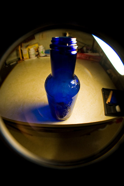 Common things can look sort of uncommon when viewed through a fisheye lens. Here's an empty Arizona Tea bottle.