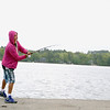 Hilario Roriguez of Fitchburg was trying to catch some fish at Lake Whalom in Lunenburg on Friday afternoon. SENTINEL & ENTERPRISE/JOHN LOVE