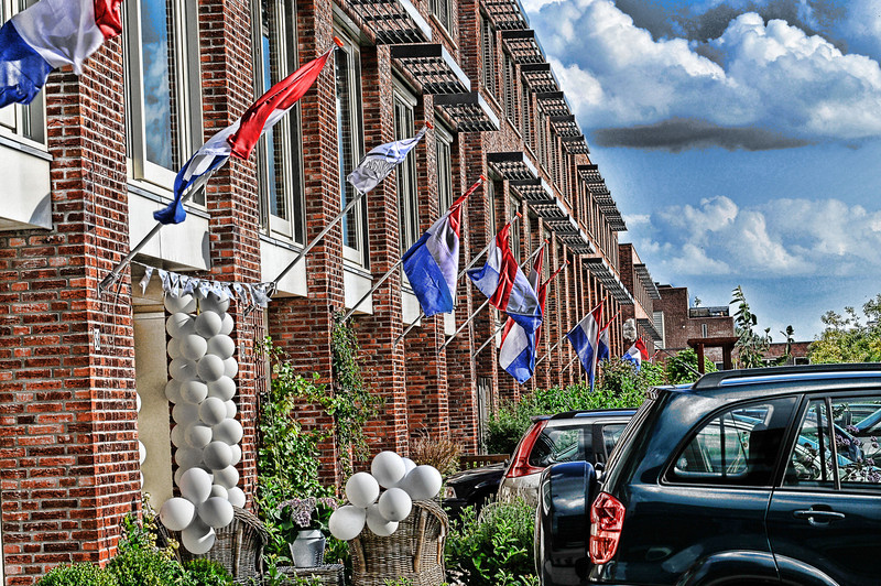 A street where I live was decorated with flags for a wedding