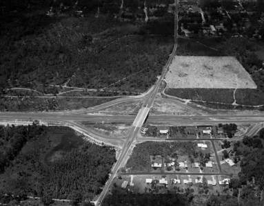 Aerial view showing an Arlington Expressway/University Blvd intersection.