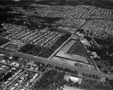 Aerial shot viewing the Arlington Plaza shopping center at the intersection of Arlington Road and Arlington Expressway in 1957.
