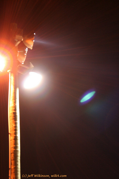 #2859, interesting light patterns and beams from a shot of a parking lot light at night