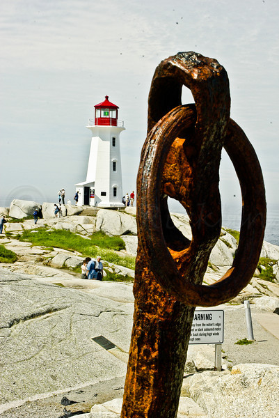 Rusty anchor and Lighthouse, Magie's Cove