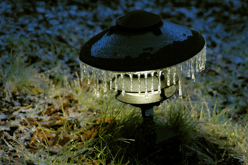 Sidewalk Light with Icicle trimmings.<br /> <br /> Winter, back rampway night light, EcoTarium, Worcester, MA ©2004
