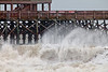 The waves sweeping through the pier at Folly Beach.
