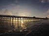 Sunrise though the pier.