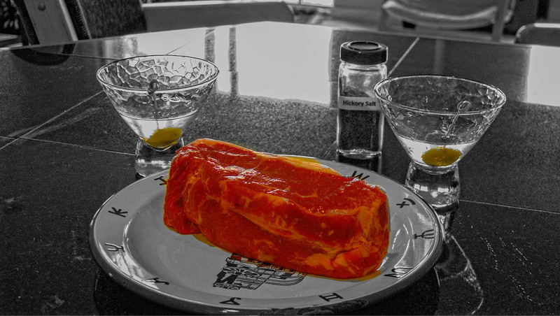 """A 2"""" thick grass fed NY strip steak awaits the grill at home in Mukilteo, Washington."""