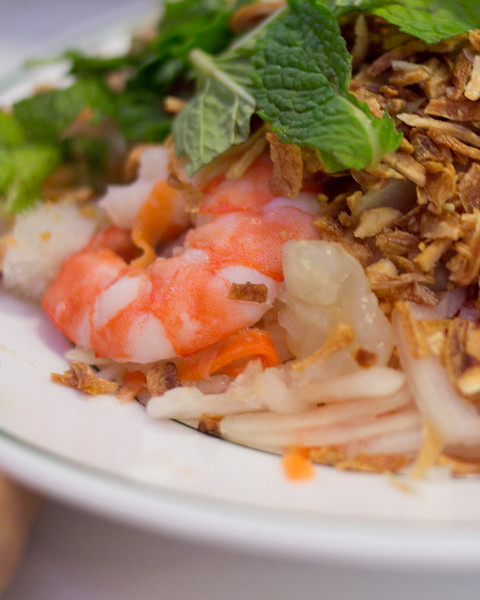 Course 1 is Goi - a mixed salad of shrimp, seafood, mint, fried onions, bean sprouts, carrots, jellyfish, beef and more
