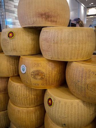Stacks of whole wheel Parmigiano