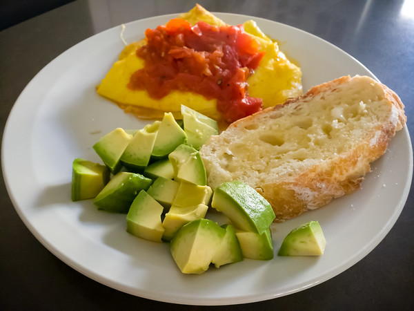 For breakfast, Valerie cooked up roasted tomatoes on a buttery cheesy omelette (Peggy-style) with a perfectly ripe avocado and homemade bread