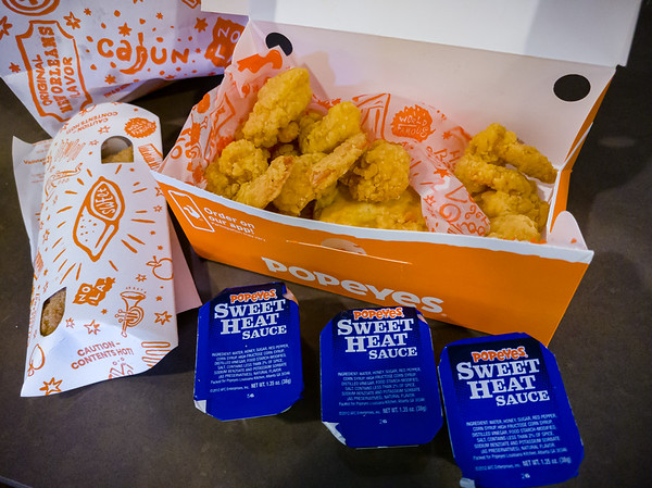 The T-Mobile Tuesday deal gave us an excuse to try Popeyes' shrimp.  The deal was for a free Shrimp Tackle Box which I mistakenly believed was the same as their Tackle Box Surf and Turf deal.  This offer came with 8 butterfly shrimp, fries, a biscuit, and dipping sauce (we decided to try the sweet heat sauce).  The latter would have had two chicken tenders, but half as many shrimp.  Either way, we liked it...and the sauce.  Valerie and I shared this with a spicy chicken sandwich and fries.  Since that dinner falls one penny short of the $5 minimum order we needed to place to claim T-Mobile's offer, we decided to try Popeye's Apple and Cinnamon Pie...hoping that it might be a substitute for McDonalds' formerly fried pie.  Unfortunately, this fried offering is covered in way too much cinnamon.  Thus far, we haven't liked any of their desserts.  Regardless, the meal was tasty and filling...we ended up with practically a whole side of uneaten fries.