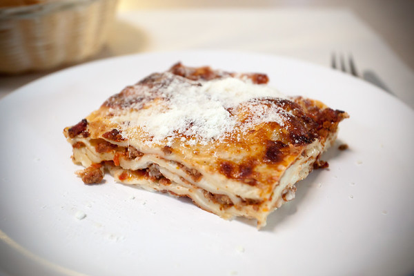 I try the Homemade Lasagne al Forno.  The noodles are wonderfully delicate and the cheese is very smooth and creamy...very good, but the portion could be larger and meatier.