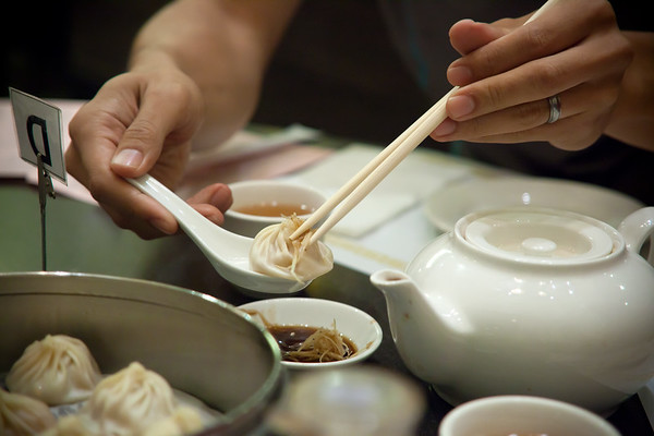 Pete demonstrates how to properly eat these soup dumplings with ginger and vinegar...and without breaking them.  The XLB's wrap is really delicate and soup inside really hot, so you have to be really careful.