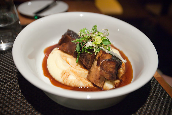 Valerie selects the Red Wine Braised Shortribs with Horseradish Potato Puree and Herb Salad...melts in your mouth!