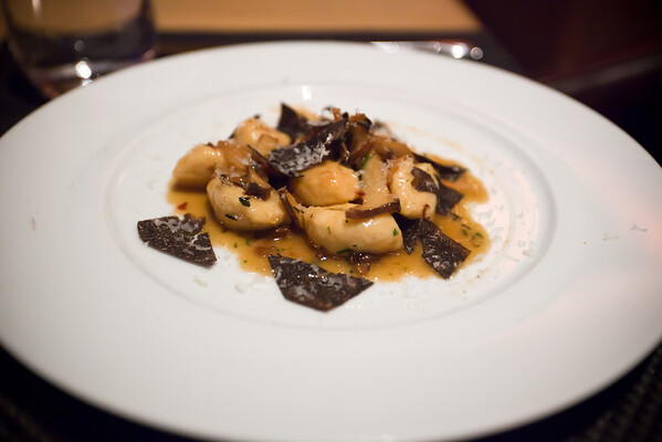 For Valerie's first course, she enjoys the Late Season Black Truffle Gnocchi