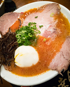 I opt for God Fire level 3 with premium toppings (I share half of my egg with Valerie). This was the perfect level of spiciness for me... good amount of kick but without overpowering the rich porkiness of the broth. The chashu may not have the same level of fatty goodness we enjoy at Tsujita or Yamadaya, but, overall, this is a worthy contender for one of the better bowls in LA. We'll be back.