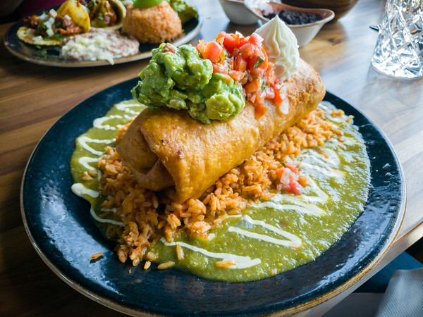 My friend Cheryl wants to try Caló Kitchen + Tequila, so I am already back for a second visit (which is already more times than I visited Cozymel's).  I obviously try the chicken chimichanga.  It does not disappoint.