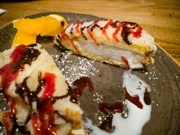 ...ice cream wrapped with pound cake, lightly tempura fried, raspberry sauce, powdered sugar