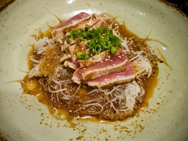 Sea Steak - Lightly seared raw tuna, shichumi soy dressing, daikon radish shoestrings, onion