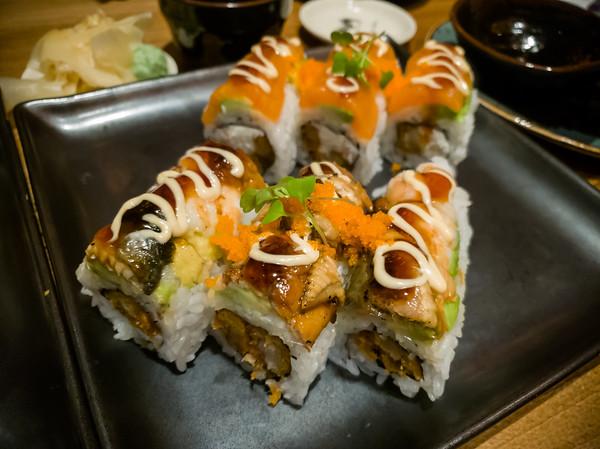 Ninety-Nine Roll (shrimp, eel, panko shrimp, avocado, sauce, masago, microgreens) and Bob's Roll (cream cheese, crab mix, panko shrimp, avocado, salmon, sauce, masago, microgreens)