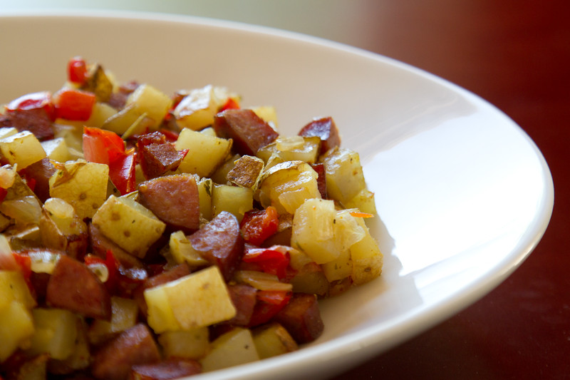 Roasted sausage, peppers, potatoes and onions