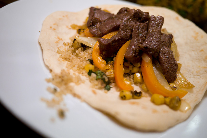 Pacific Rim Fajitas: Beef Bulgogi accompanied with cilantro-lime quinoa, fire roasted corn, sauteed bell peppers and onions atop a hand-made tortilla. - shot with Panasonic DMC-GH2 1/50 sec at f/1.7, ISO 400 with 20 mm lens