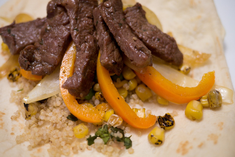 Pacific Rim Fajitas: Beef Bulgogi accompanied with cilantro-lime quinoa, fire roasted corn, sauteed bell peppers and onions atop a hand-made tortilla. - shot with Panasonic DMC-GH2 1/30 sec at f/1.7, ISO 400 with 20 mm lens
